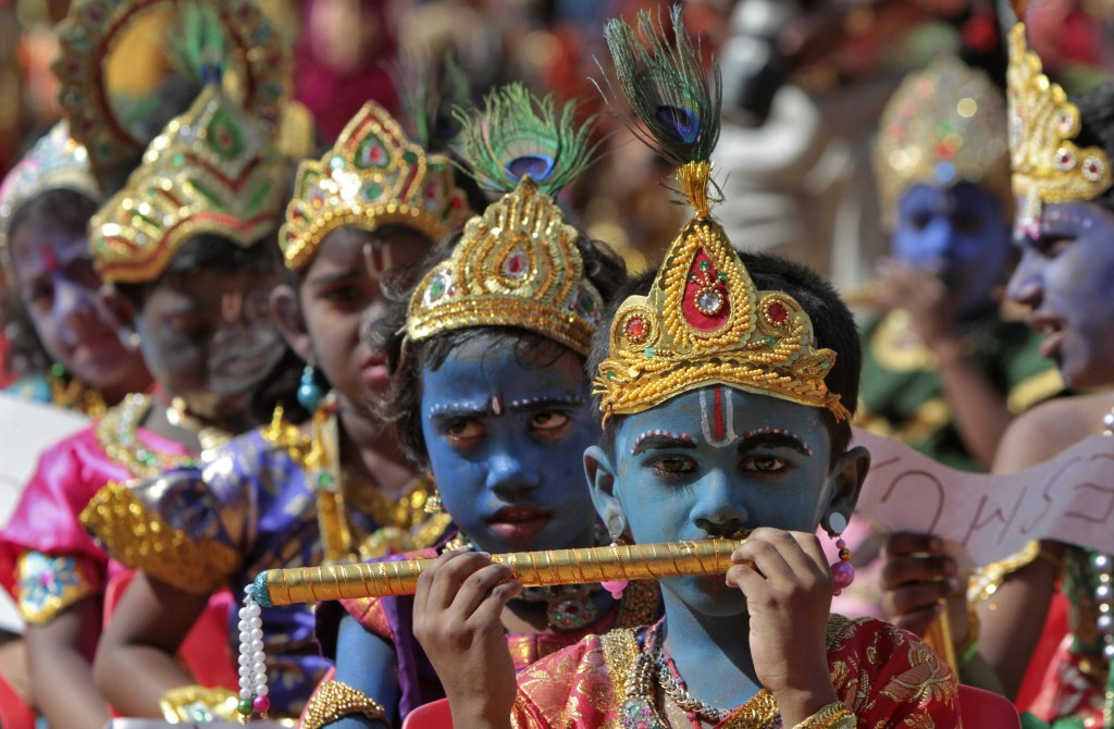 """School children dressed as Hindu Lord Krishna take part in a function held ahead of """"Janamashtmi"""" celebrations in the southern Indian city of Chennai"""